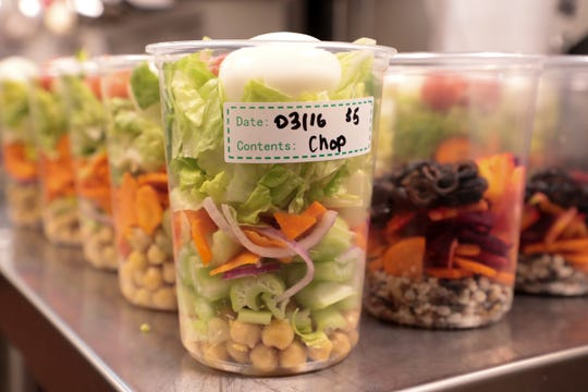 Salads sit prepared in Dringk Eatery + Bar kitchen in Rancho Mirage, Calif. on Monday, March 16, 2020. The restaurant is selling food for stocking one's fridge in the midst of the coronavirus.
