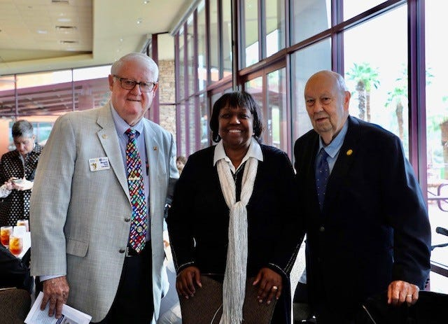 Ricardo Loretta, past district governor of Rotary, and Bill Kroonen, past president of College of the Desert with Citizen of the Year award honoree Judy White on March 10, 2020.