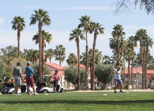 Golfers tee off on the 17th hole at Tahquitz Creek Golf Resort in Palm Springs, March 16, 2020.