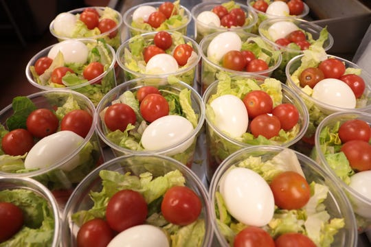 Chop salads sit prepared in Dringk Eatery + Bar kitchen in Rancho Mirage, Calif. on Monday, March 16, 2020. The restaurant is selling food for stocking one's fridge in the midst of the coronavirus.