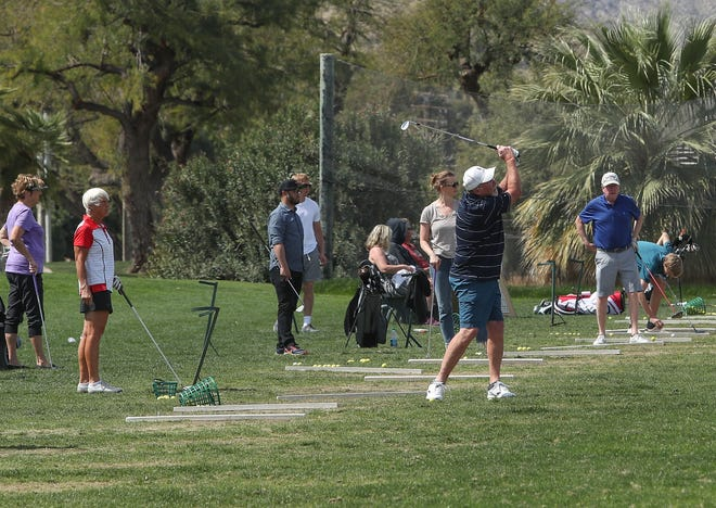 Golfer hits balls on the driving range at Tahquitz Creek Golf Resort in Palm Springs, March 16, 2020.  A large number of golfers were on the course despite the coronavirus.