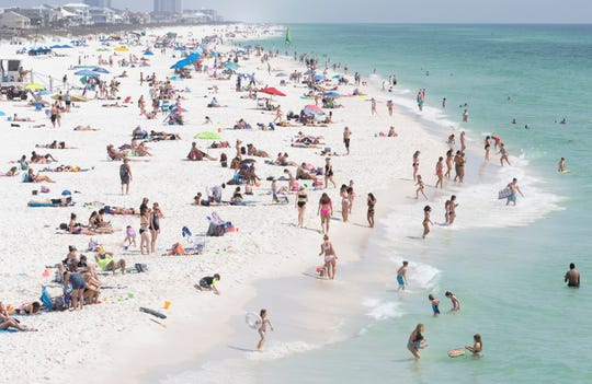 The shore is crowded during Spring Break at Casino Beach in Pensacola on Tuesday, March 17, 2020.