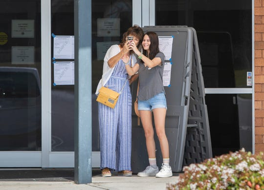 First-time voter Frances Moore and her mother, Rebecca Moore, take a selfie after voting Tuesday at the Gulf Breeze Community Center.