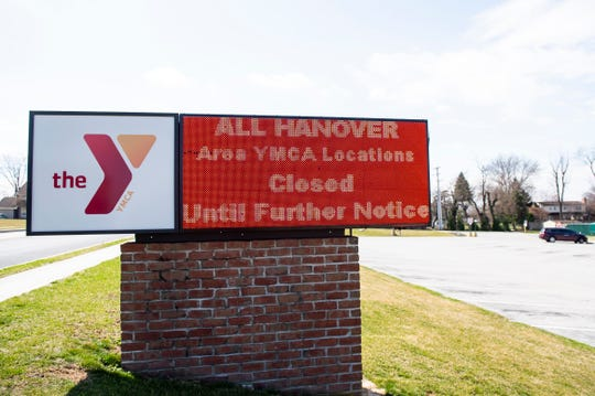 An electronic sign outside the North Hanover YMCA notifies passersby that all Hanover-area YMCA locations (including Littlestown) are closed until further notice.