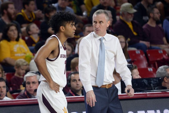 Arizona State Sun Devils head coach Bobby Hurley talks with guard Remy Martin (1) during the first half against the Washington State Cougars at Desert Financial Arena during the team's final game of the season.