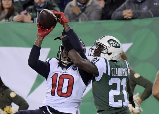 Houston Texans wide receiver DeAndre Hopkins (10) catches a 14-yard touchdown pass in the fourth quarter as New York Jets cornerback Morris Claiborne (21) defends at MetLife Stadium in 2018.