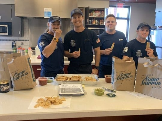 Fire fighters in Gilbert dug into a feast of chimichangas and taquitos donated to the station by local restaurant chain Someburros.