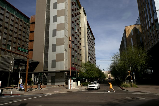 With ASU classes having shifted entirely to online because of coronavirus concerns, Taylor Street in front of the Taylor Place dorms are nearly empty on the first day of classes after spring break in downtown Phoenix on March 16, 2020.