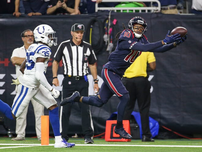 Wide receiver DeAndre Hopkins (10) makes a reception for a touchdown as Indianapolis Colts cornerback Pierre Desir (35) defends during the fourth quarter at NRG Stadium last season.