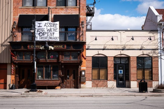 A sign referencing the movie 'Clerks' hangs on the front of The Raven Tuesday, March 17, 2020, in downtown Port Huron.  It was ordered Monday morning that all restaurants close to dine-in customers to help prevent the spread of coronavirus.