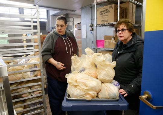 Beacon City School District director of food services Karen Pagano moves prepared lunches from the kitchen to the staff outside of the school for distribution at South Avenue Elementary School in Beacon on March 17, 2020.