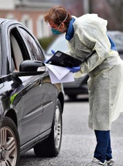 Ann Elliott, R.N., works at the drive up COVID-19 coronavirus testing site at WellSpan Family Medicine - Cape Horn in Windsor Township, Tuesday, March 17, 2020. Candidates must be directed to the facility for testing by a physician prior to arrival. Dawn J. Sagert photo