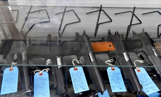 An entire shelf normally filled with handguns sits empty at Bluestone Firearms in Lower Windsor Township as customers worried about the pandemic stock up on guns and ammunition, Tuesday, March 17, 2020. John A. Pavoncello photo