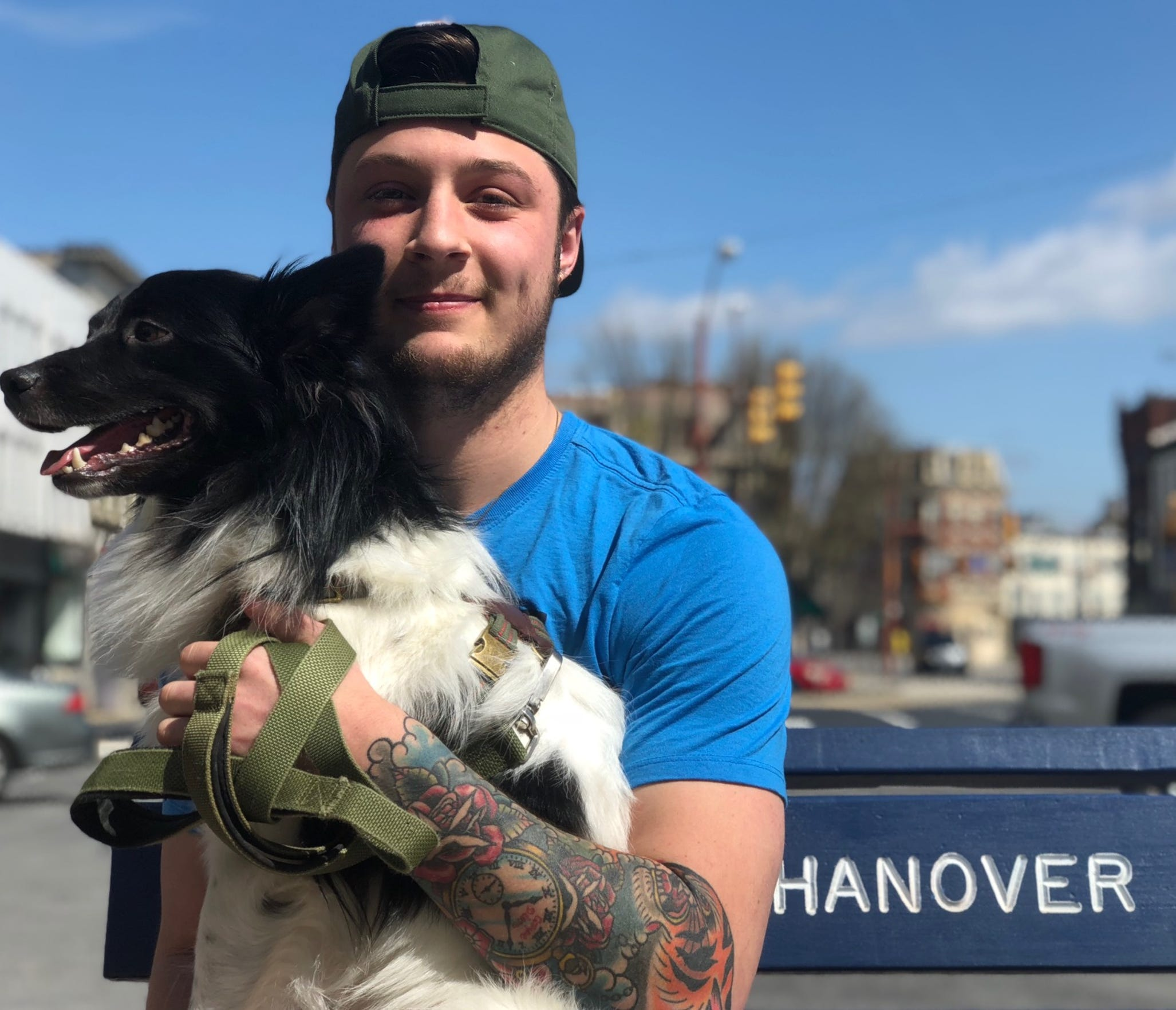 Jonathan Volee, 22, is out with his dog, Kedo, in Hanover on Tuesday, March 17, a day after Gov. Tom Wolf ordered many businesses shut down to prevent the spread of coronavirus, now a global pandemic.