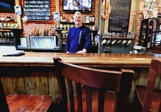 Mudhook Brewing Company owner Jeff Lau stands in the empty bar Tuesday, March 17, 2020. Like many state eateries, the business is offering takeout menu selections and beer after a mandate by Gov. Tom Wolf that bars and restaurants close, except for takeout and delivery service. It's hours of operation are scaled back to 4 p.m. to 8 p.m. He said he plans to use the downtime to do maintenance on the building and prepare for a full reopening. Bill Kalina photo