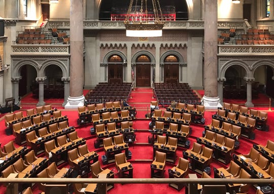 The New York State Assembly chamber sits empty on March 17, 2020, as the coronavirus continues to spread throughout the state. Two Assembly members have tested positive.