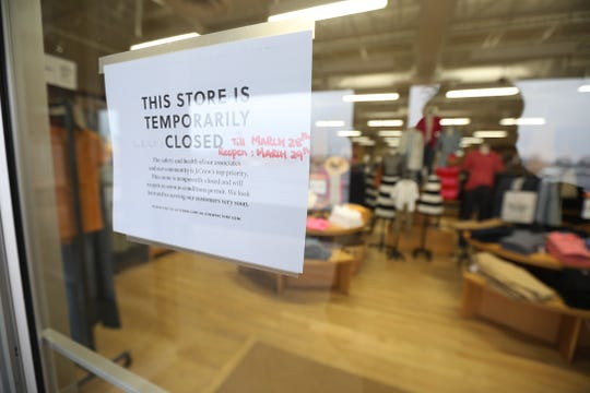 A sign on J. Crew's at Pittsford Plaza, Tuesday, March 17, 2020 states they are closed temporarily and will reopen March 29.  Many businesses have changed hours or closed due to COVID-19.