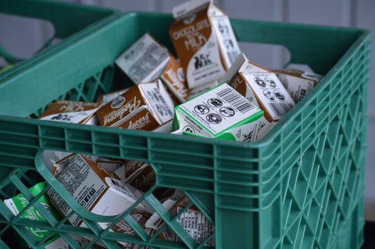 Boxes of regular and chocolate milk were prepared for students at Shasta Meadows Elementary School on March 17, 2020.