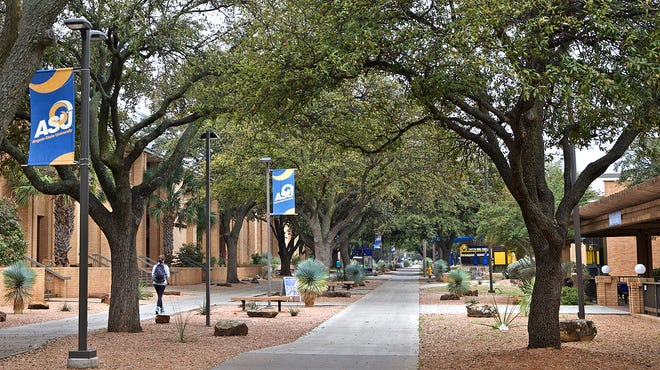A lone student walks on the Angelo State University campus on Tuesday, March 17, 2020 as the college announced the postponement of commencement ceremonies in May.