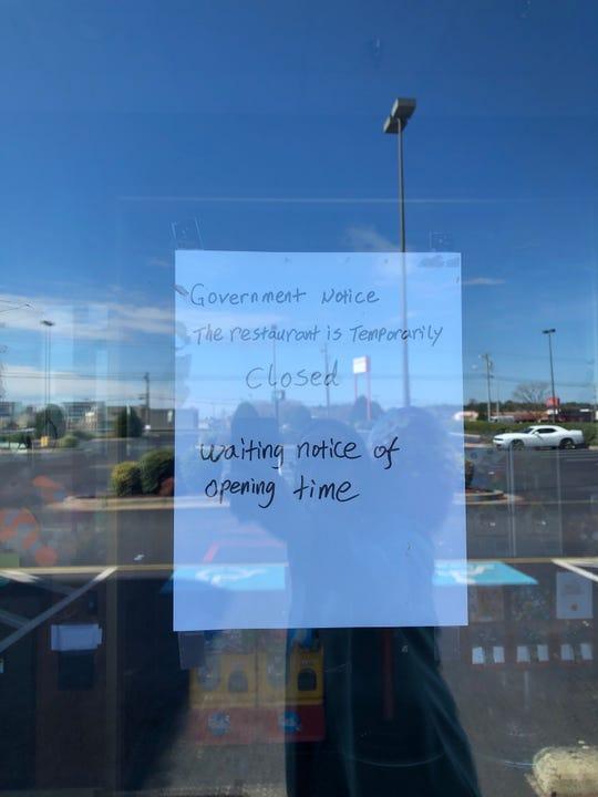 The closure notice on the door of Flaming Grill restaurant in North Salisbury.