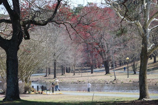 Only a few people ventured out to Salisbury City Park in the warm spring weather Tuesday, March 17, 2020, due to recommendations from epidemiologists and the government to socially isolate to stop the spread of the novel coronavirus.