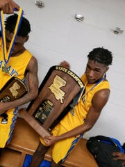 Pleasant Hill athletes celebrate with the LHSAA Class C state championship trophy.