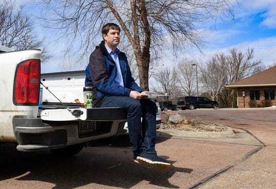 Dan Ahlers, Democratic candidate for US Senate, waits outside to encourage participation in drive-through petition signing on Tuesday, March 17, on Cleveland Ave. in Sioux Falls.