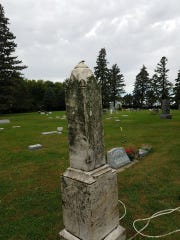 A headstone in the Dell Rapids cemetery before Steve Sittig was able to give it a deep clean.