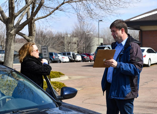 Dan Ahlers, Democratic candidate for US Senate, talks to Lori Berdahl while conducting drive-through petition signing on Tuesday, March 17, on Cleveland Ave. in Sioux Falls.