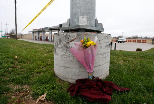 A bouquet of flowers at the Kum & Go gas station on Tuesday, March 17, 2020 where a gunman killed four people, including a police officer, late Sunday night. Two others were shot, including another officer, but still alive. The gunman also died from a self-inflicted gunshot, according to the police.
