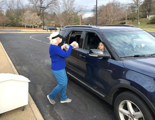Cheryl Adkins distributes meals to a family at Westwood Hills Elementary School Tuesday morning, March 17. Breakfast and lunch meals are available to families of children in the Waynesboro Public School system during the current school closure.