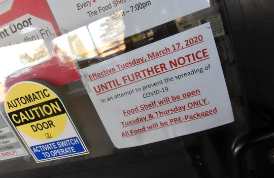 A sign announces changes to the food shelf schedule Tuesday, March 17, 2020, at the Salvation Army Shelter in St. Cloud.