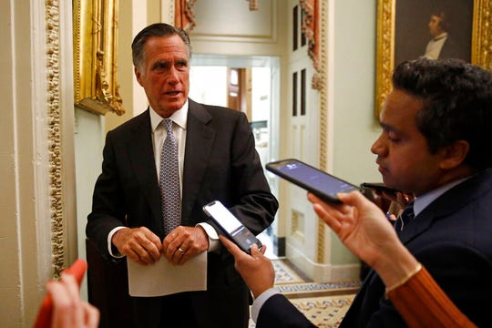 Sen. Mitt Romney, R-Utah, speaks with members of the media as he departs a meeting with Treasury Secretary Steve Mnuchin on an economic lifeline for Americans affected by the coronavirus outbreak on Capitol Hill in Washington, Monday, March 16, 2020. (AP Photo/Patrick Semansky)