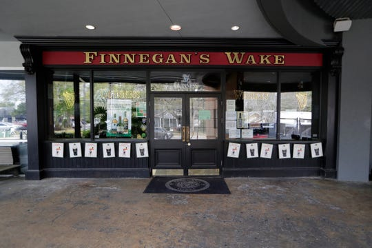 The owners of Finnegan's Wake and Fifth and Thomas bars in Midtown made the decision Monday to shut down for the foreseeable future, canceling one of their biggest events of the year, an annual St. Patrick's Day party, and laying off around 27 employees.