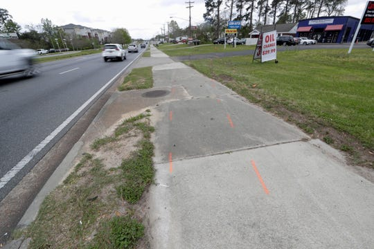 Damage can be seen at the scene Tuesday, March 17, 2020, along West Tennessee Street near the corner of Dixie Drive where a woman was killed and her grandchild, who she was pushing in a stroller, was seriously injured after they were struck by a car Monday night.