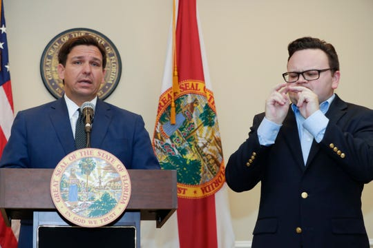 Gov. Ron DeSantis speaks during a press conference where he announced the closure of bars and nightclubs for 30 days and mandatory social distancing and crowd capacity measures for restaurants Tuesday, March 17, 2020.