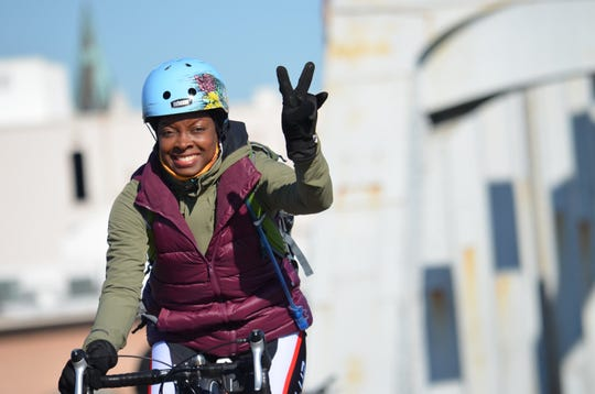 In February 2020, Tallahasseean Joelle Henry and a few of her bicycling friends took on the Selma 55 Ride in Alabama. Joelle Henry holds up the peace sign.