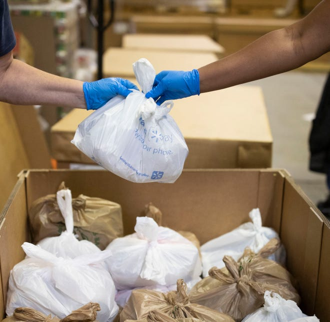 Volunteers bagged food at Second Harvest Food Bank for a March 17, 2020 distribution.