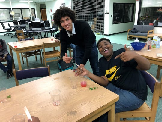 High school student Kenneth Greene participates in a STEM Out program at Nims Middle School with seventh-grader Jason Henderson in February 2020.