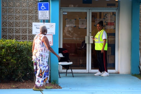 Community members begin to slowly trickle in to the precinct on Tuesday, March 17, 2020, at the Gifford Community Center in Indian River County. As of 9:30 a.m., 1,260 people have voted in person in Indian River County according to Leslie Swan, Indian River County supervisor of elections.
