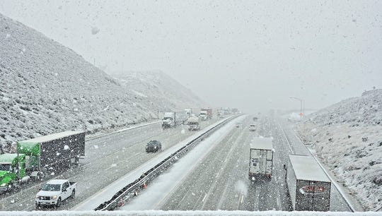Authorities closed the Grapevine section of Interstate 5 for a time as snow fell on Tejon Pass late Monday afternoon.