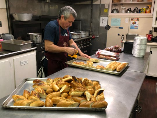 Tony Centeno prepared garlic bread at the Vineland Soup Kitchen. March 17, 2020