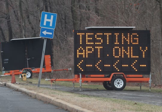 A sign set up to direct people to tents set up on the grounds of the Westchester Medical Center in Valhalla for  Coronavirus testing by appointment only March 17, 2020.