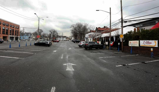 The normally crowded municipal parking lot behind the restaurants and bars on Mamaroneck Ave. in White Plains was mostly empty March 16, 2020. With restaurants and bars closed due to coronavirus concerns, restaurants were limited to take-out and delivery service.