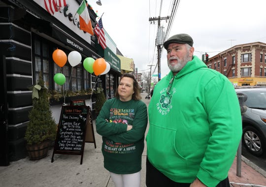 Ellen Shannon and Brian Kenny are decked out for St. Patrick's Day as they head into The Heritage Bar and Restaurant and Eileen's on McLean Avenue in Yonkers, as they prepare to pick up their take-out order, March 17, 2020.