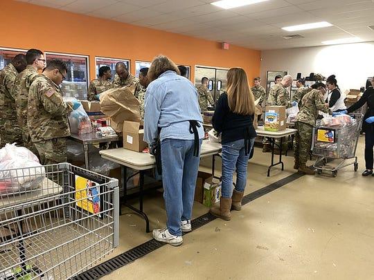 Volunteers sort food at Feeding Westchester