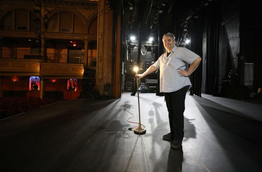 """Bjorn Olsson, the executive director of the Tarrytown Music Hall in Tarrytown, is pictured on the stage with the """"ghost light"""" March 17, 2020."""
