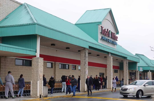 Shoppers line up before the opening of a Total Wine in Delaware