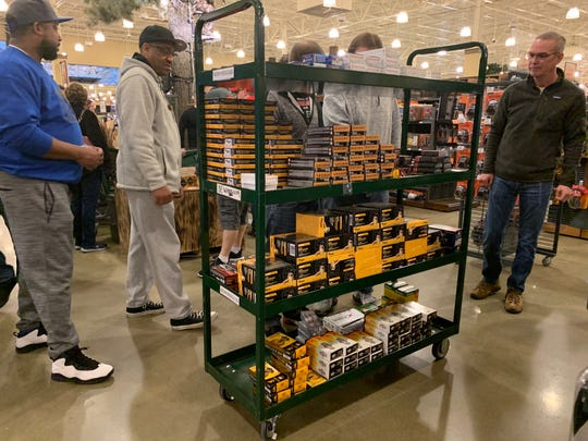 Shoppers visit an ammunition rack at Cabela's on Tuesday, March 17, 2020.