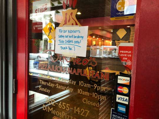 DiMeo's Pizza on Market Street in Wilmington was only accepting takeout orders on Tuesday. Still, the restaurant boasted a line typical of a weekday lunch hour.